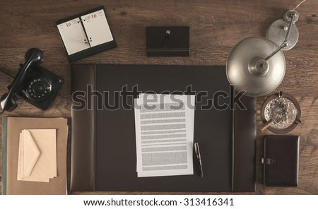 1950s style office with a contract and a pen, top view
