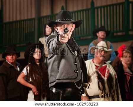 1800's western sheriff with gun drawn at point blank range