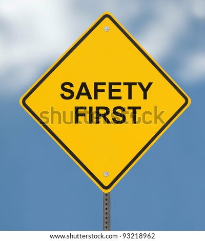 """Safety First"" sign on a blue sky background(with clipping path)"