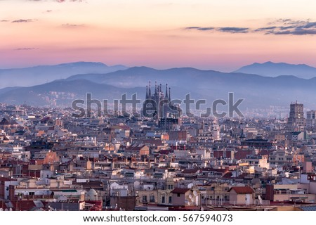 Shutterstock  Sagrada familia and panorama view of barcelona city at dusk ,Spain