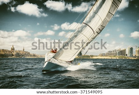 . Sailing yachts regatta.  Yachting. Sailing. Toned image and blur. Retro style postcard.