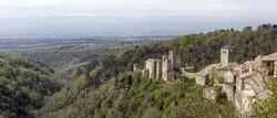 Saissac castle's view vith snowy Pyrinees