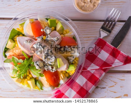 Salad With Chicken Grill Ingredients: grilled chicken breast, grilled corn grains, fresh tomatoes, blue mold cheese, arugula leaves, iceberg spinach and lettuce, boiled eggs, dressing based on French #1452178865
