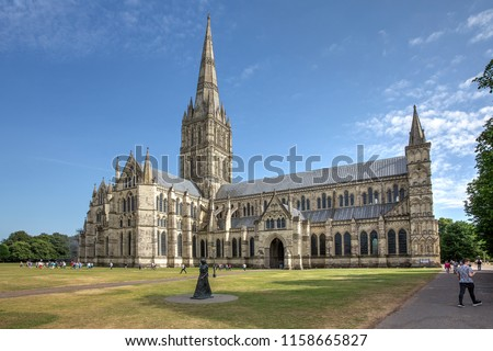 "Salisbury Cathedral on a summer afternoon as seen from the North. In the foreground is the Statue of the ""Walking Madonna"" by Elizabeth Frink #1158665827"