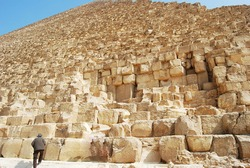 Sandstones of the Great Pyramid of Giza. Man on the bottom left for size comparison.