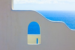 Santorini Greece, Whitewashed wall with sea background Santorini island in Greece