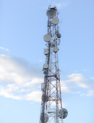 scaffolding with antennas on a blue background