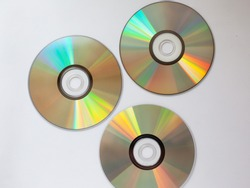 3 scattered cd compact disk with music on a white background close-up
