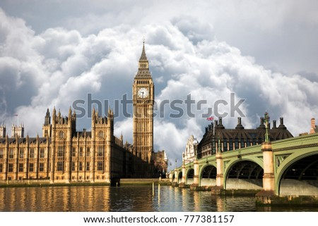 Scene of Big Ben and Palace of Westminster seen from South Bank, Dramatic Sky present in the background.