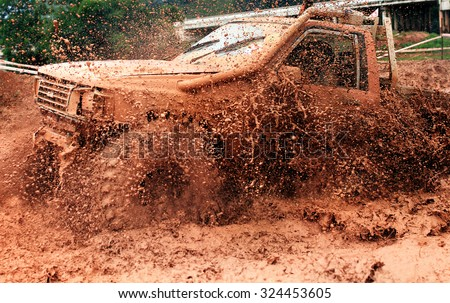Scene of mud splash in off-road racing.