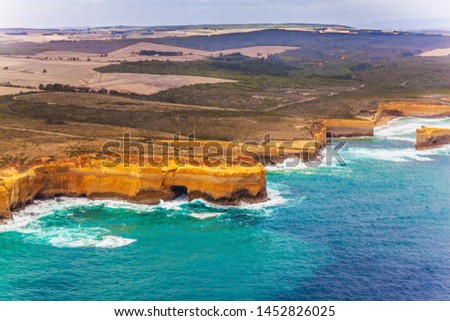 Scenic coastline. Great Ocean Road and the Twelve Apostles - group of limestone cliffs on Pacific coast. Australia. Picture taken from a helicopter. The concept of extreme, active and photo tourism