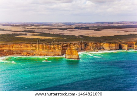 Scenic coastline. Picture taken from a helicopter. Great Ocean Road and the Twelve Apostles is a group of limestone cliffs. Pacific Ocean, Australia. The concept of extreme, active and photo tourism