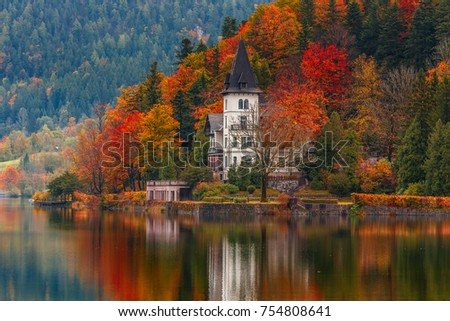 schloss lake Grundlsee, Villa Castiglioni in colorful forest reflected in water, Dramatic autumn scenery over lake Grundlsee, Salzkammergut, Styria, Austria. Beautiful in the world. creative imag