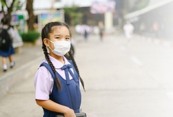 School Girl  wearing mouth mask against air smog pollution in Bangkok city, Thailand , concept of Corona virus quarantine,Covid-19