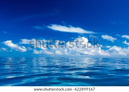 sea surface summer wave background. water landscape with clouds on horizon. Natural tropical water paradise. Ocean nature tranquility #622899167