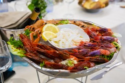 Seafood appetizer with purple prawns from Gallipoli, typical Apulian crustaceans