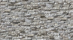 Seamless texture wall stone sandstone with shadows and deep texture. Clinker tiles or bricks on the wall in the form of wild stone