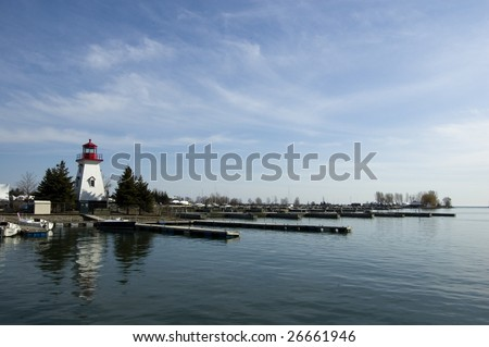 seascape with  light house on the background /  toronto's  yacht club with blue sky
