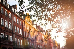 (selective focus) Beautiful red apartments illuminated at sunset in the Chelsea district in London, United Kingdom.