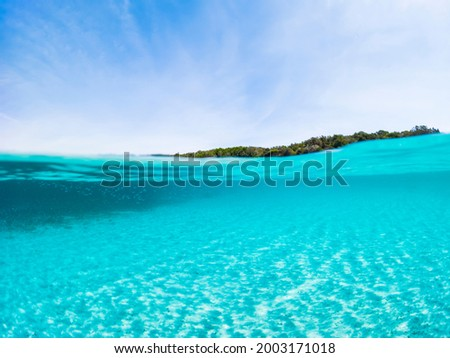 (Selective focus) Stunning view of half underwater sea and half blue sky. La Maddalena Archipelago, Sardinia, Italy. Concept, split, fifty fifty, natural background with copy space. Foto stock ©