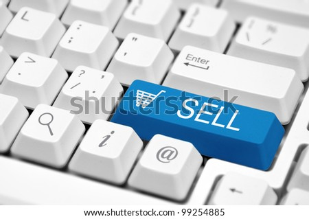 """Sell"" icon button on the key of a computer keyboard"