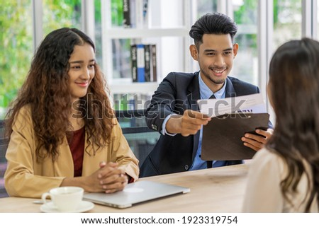 Senior Asian Manager explaining or answering about job description and benefits to Young Asian woman graduate with positive motion in meeting room,Business Hiring new member concept Сток-фото ©