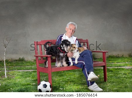 Senior man with dogs sitting on bench
