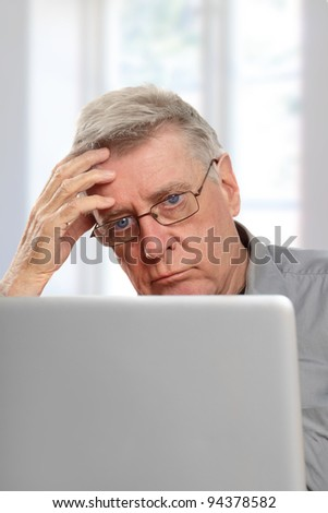 senior using laptop - stock photo