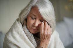 Senior woman at home feeling unwell