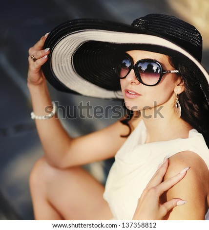 sensual young summer girl wearing a hat  and sunglasses