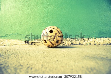 Sepak Takraw Ball On Cement Background,Asia Traditional Sport Games