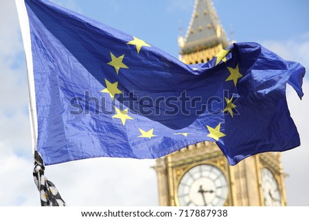9 September, 2017. Westminster London. The EU flag flying in front of Big Ben during an anti-Brexit pro-EU EU protest. #717887938