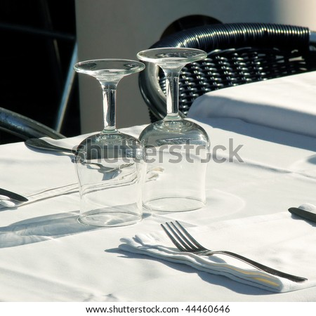 served table with glasses at restaurant of barcelona - stock photo