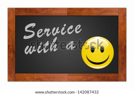 """""""Service with a Smile"""" written with chalk on a wooden frame blackboard"""