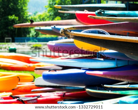 Set of canoes and kayaks on a lake in the Pyrenees