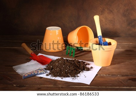 Set of gardening tools and pots