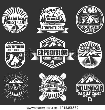 set of outdoor adventure emblems, badges, labels, logo in retro style. Vintage chalkboard mountain forest camp hiking and expedition symbols, icons, typography design elements.