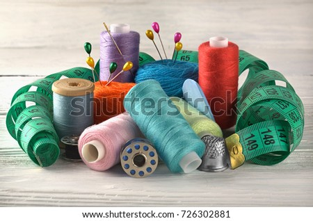 set of sewing threads, on reels and a centimeter