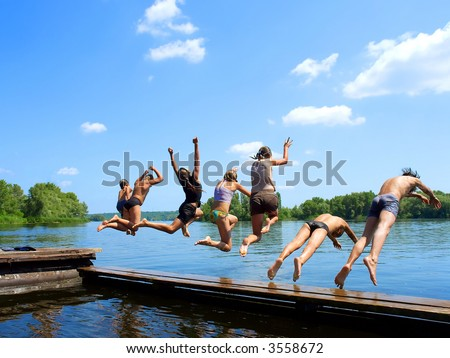 'Seven samurai group of kids jumps into water from pier Shot in June Dnieper river Ukraine.