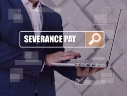 SEVERANCE PAY phrase on the screen. Manager use internet technologies at office.