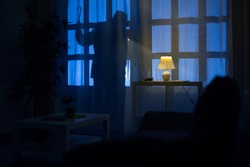 shadow  of burglar on the balcony door