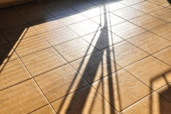 Shadows, on brown ceramic floor, old style, retro or vintage, with shadow drawings of architecture, Brazil, South America, abstract style, scene background or texture