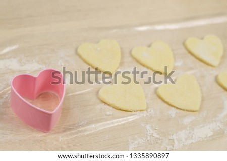 shape for cookies in the shape of a heart on the table #1335890897