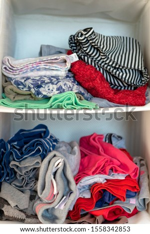 Shelf clothes. Clothes in the closet. clothing on shelves