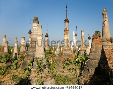 Shwe Inn Thein Paya, Indein, (Nyaungshwe),  Inle Lake,Shan state, myanmar (Burma). Weather-beaten buddhistic zedi constructed in 17th and 18th century damaged by earthquake in 1975 - stock photo