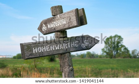 Signpost on the popular Elbe Cycle Route between Magdeburg and Hohenwarthe                             #1419041144