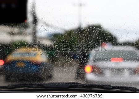 Silhouette edge The rain is falling. Bokeh on the road in the morning. In Thailand.Abstract blurred background : Traffic jam in the morning rush hour. in-Thailand. #430976785