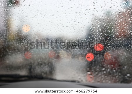 Silhouette edge The rain is falling. Bokeh on the road in the morning. In Thailand.Abstract blurred background : Traffic jam in the morning rush hour. in-Thailand. #466279754