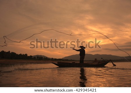 Silhouette Livelihoods of fishermen casting fishing #429345421