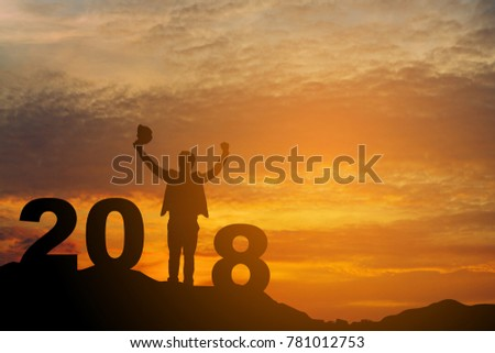 silhouette of a businessman hand raised above his head. With the sun falling, the men, the religions, the horoscopes, the religions, worship, prayers and praise. Happy Christmas and Happy New Year #781012753
